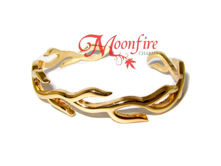 THE HUNGER GAMES: CATCHING FIRE Haymitch's Gold Fire Bangle