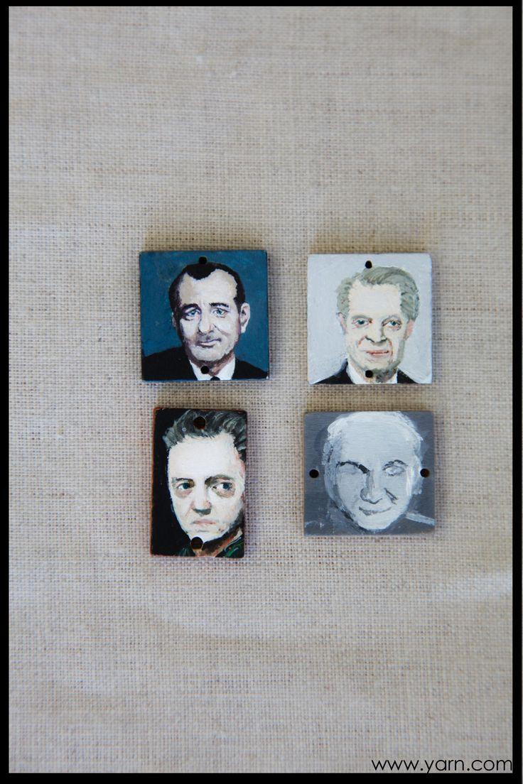 Deb paints small wooden tiles. These are Bill Murray, Steve Buschemi, Christopher Walken, and Steve Martin in progress.