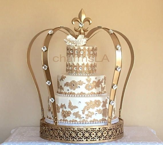 The biggest Gold crown cake stand and 3 Tier Fake Wedding Cake Covered with REAL Fondant Cake Dummy Display Wedding Cake With Gold Lace #cakestand #cake #cakes #crown #cakedecorating #cake design #caketopper #cakestand #crown #prince #babyshowerdecorations #babyshowercakes #babyshowerideas #birthdaycake #birthdayideas #princebirthday #ad