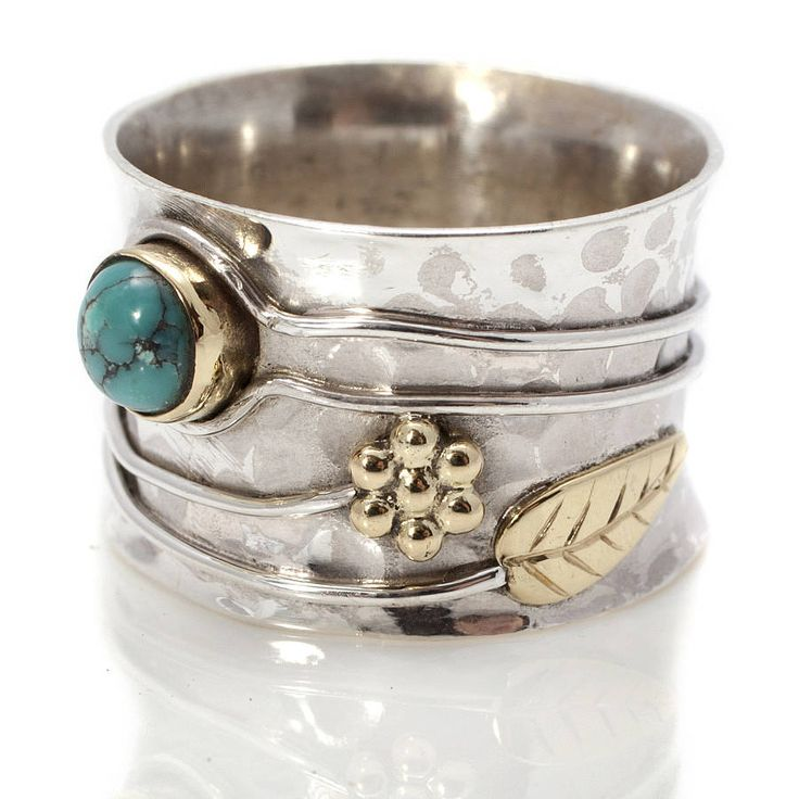 A stunning, handmade Turquoise or Ruby Silver Ring with a pretty flower design. £49.00