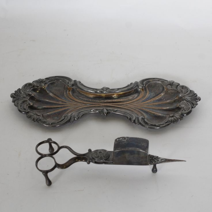 Silver wick cutter and tray.