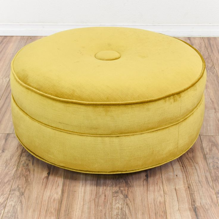 This round ottoman is upholstered in a durable light yellow green velvet upholstery. This large ottoman is in good condition with a round cushioned top, a tufted middle and piping trim. Stylish seat perfect for adding a pop of color! #contemporary #chairs #ottoman #sandiegovintage #vintagefurniture