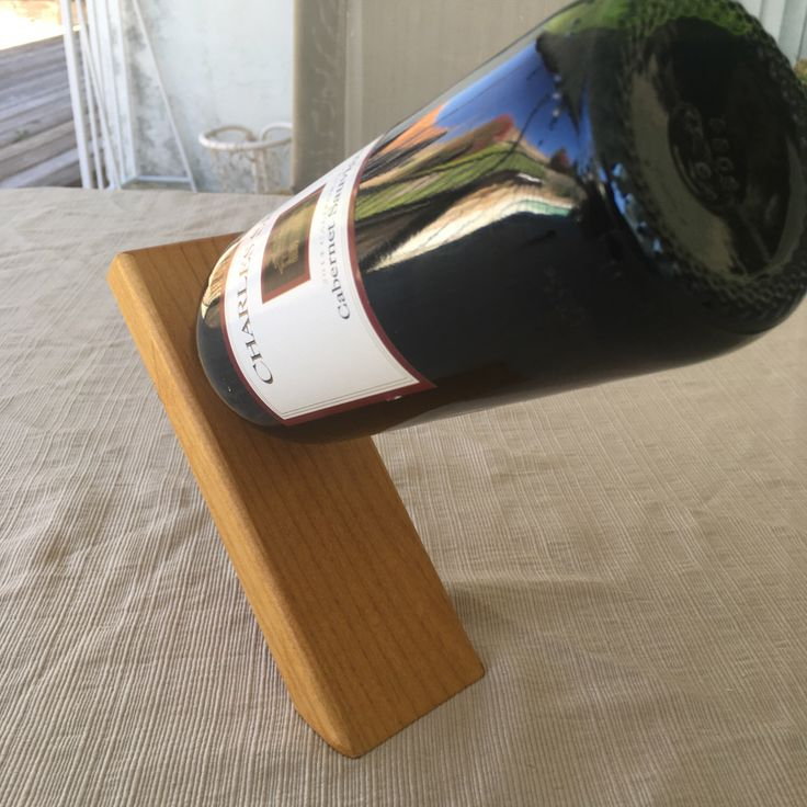 Wine Bottle Balancing Stand by Popsnsons on Etsy https://www.etsy.com/listing/468037898/wine-bottle-balancing-stand