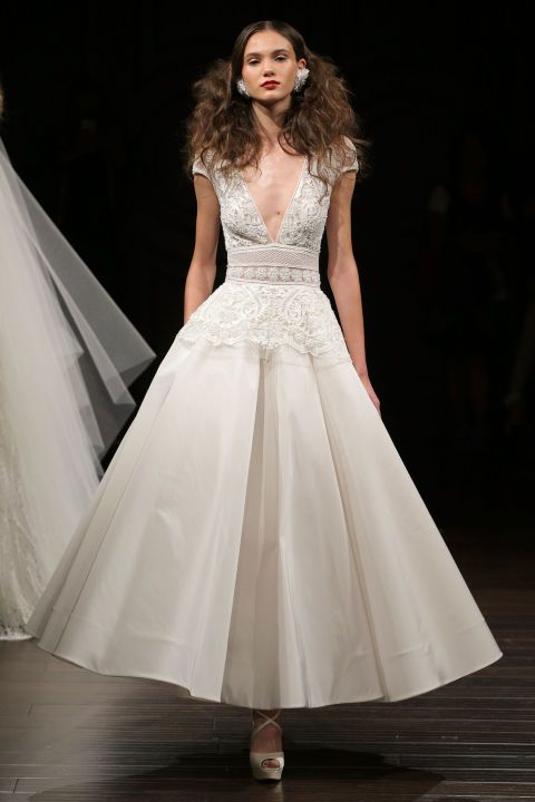 Naeem Khan's plunging wedding dress mixes both sexy and sweet in one of the the best short wedding dresses from Fall Bridal Week -- keep it short and sweet!