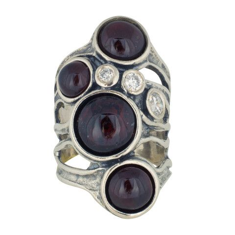 Changing Tides (CT010) Hear the sound of the waves with this sterling silver ring featuring 4 round garnet stones and 3 rose cut cubic zirconia stones.