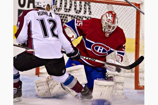 Canadiens goalie Dustin Tokarski makes the save with Avalanche forward Jarome Iginla on the doorstep in Friday night's game in Quebec City.