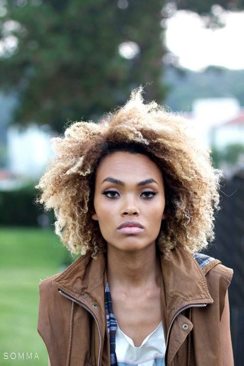 gorgeous natural hair with a honey blonde colour.