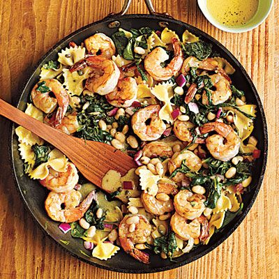 """Warm Pasta Salad with Shrimp: """"Pantry-friendly ingredients make this pasta salad easy on your budget. Toss warm pasta with the tangy dressing so it will absorb more flavor. If you prefer to serve this salad chilled, make it up to a day ahead, toss, and refrigerate until you're ready to serve."""""""