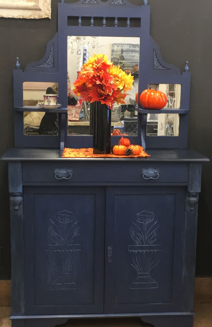 Petite buffet hutch painted in napoleonic blue and highlights of Greek blue, with clear black wax chalkpaint by Annie Sloan at B/A Vintage Whitby
