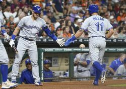 Aug 5, 2017; Houston, TX, USA; Toronto Blue Jays center fielder Kevin Pillar (11) celebrates with third baseman Josh Donaldson (20) after scoring a run during the seventh inning against the Houston Astros at Minute Maid Park. Mandatory Credit: Troy Taormina-USA TODAY Sports