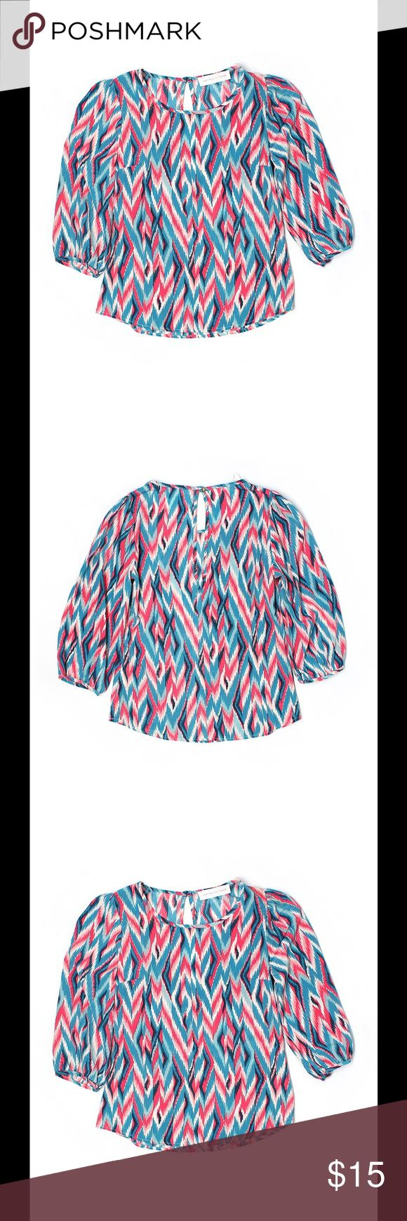 "💕 PEACHES N CREAM bright chevron blouse top the PEACHES N CREAM bright chevron top ♡  scoop neckline gold tone textured button at neck 3/4 Sleeve chevron / herringbone pattern teal, pink, black, cream, bright salmon print 32"" chest, 20"" length 100% polyester hand wash   condition: excellent condition ♡   💕 PEACHES N CREAM  Tops Blouses"