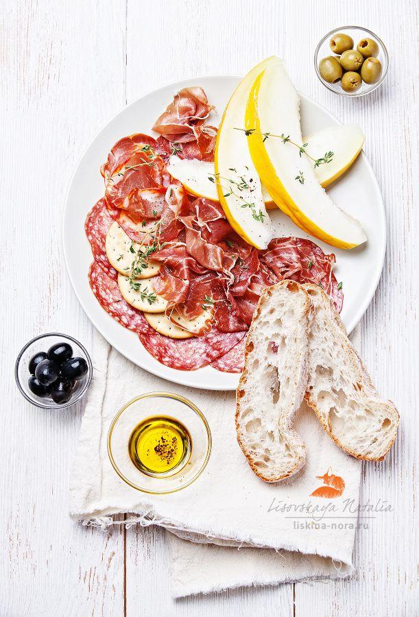 beef carpaccio, salami, pears with truffle oil and olives    хамончик с дынькой by Natalia Lisovskaya