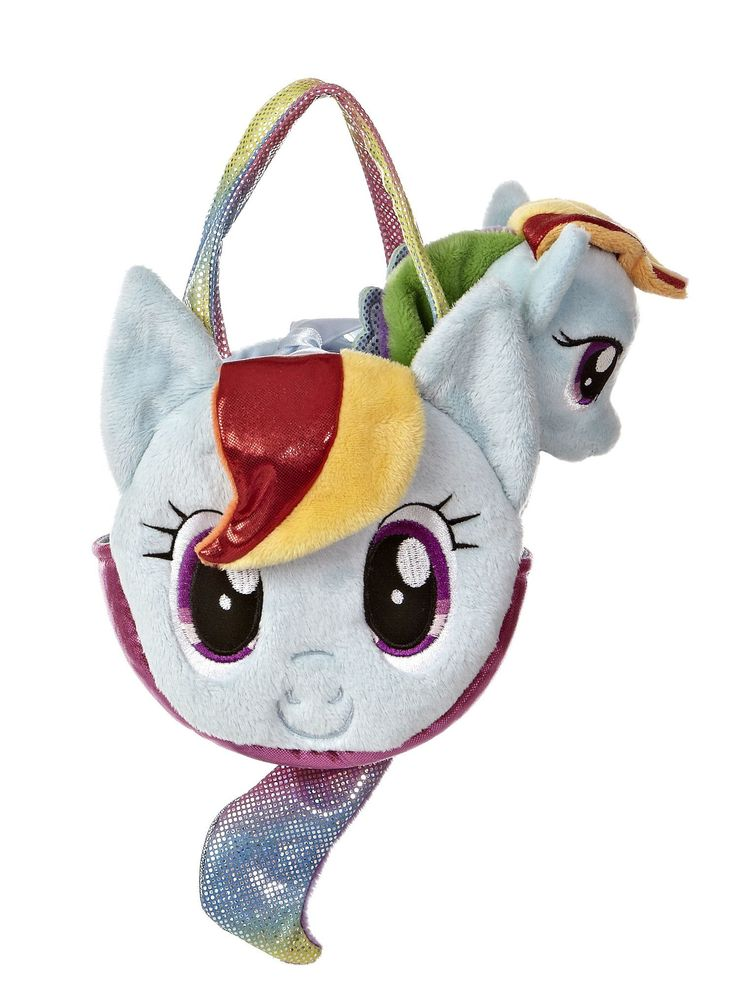 "6.5"" Rainbow Dash comes in a rounded face-shaped carrying purse complete with a pony tail on the back. Rainbow Dash is a beautiful pale blue winged horse with a rainbow mane and tail. Includes a keeps"