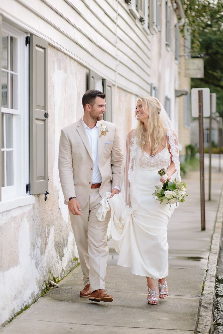 This adorable bride and groom outside Zero George Hotel in downtown Charleston, SC