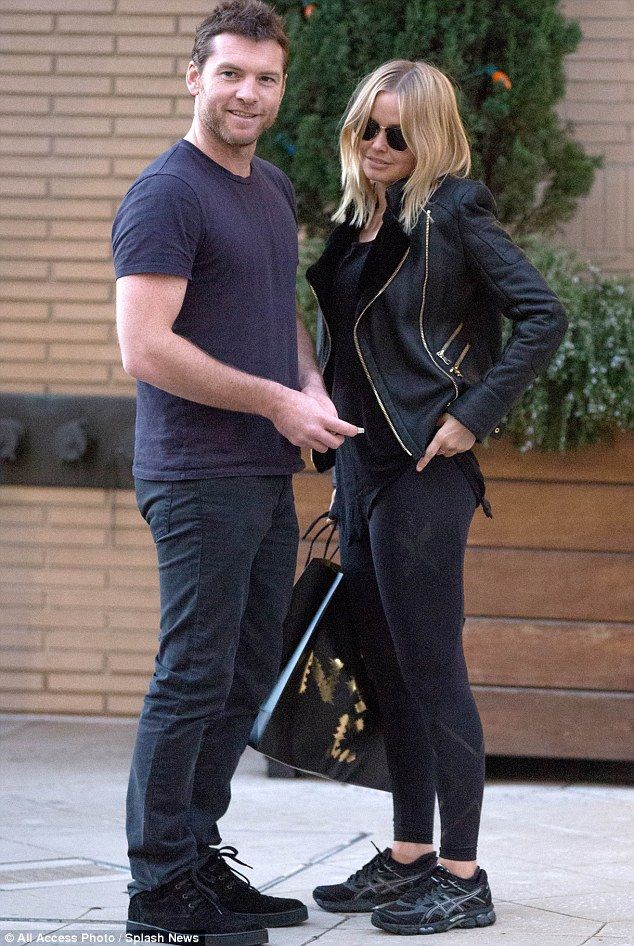 Happy couple: Sam Worthington and Lara Bingle, pictured here at Barneys in Beverly Hills on Dec. 1, have been dating since the end of Septem...