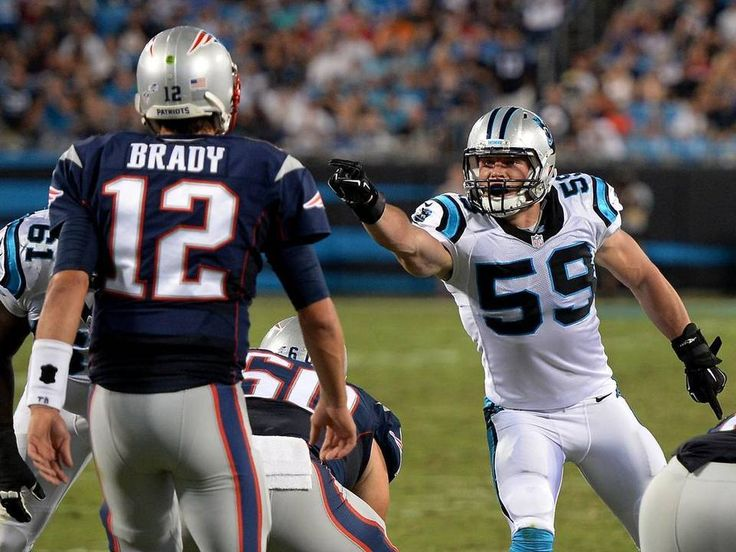 Carolina Panthers linebacker Luke Kuechly, right, points and yells out instructions to the defensive line as New England Patriots quarterback Tom Brady prepares to call a play during second-quarter action at Bank of America Stadium in Charlotte on Friday.