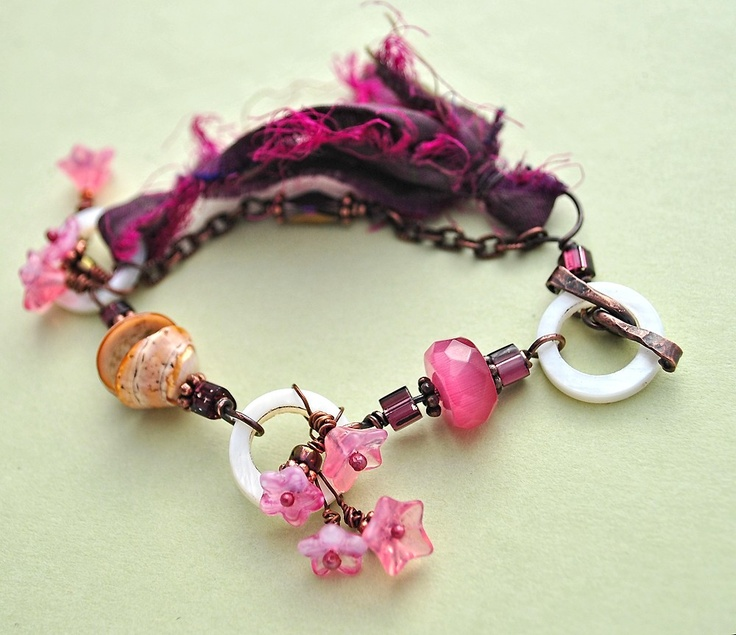Cherry Blossom Festival: Bracelet of Shell, Glass, Sari Silk, and Antiqued Copper. $25.00, via Etsy.