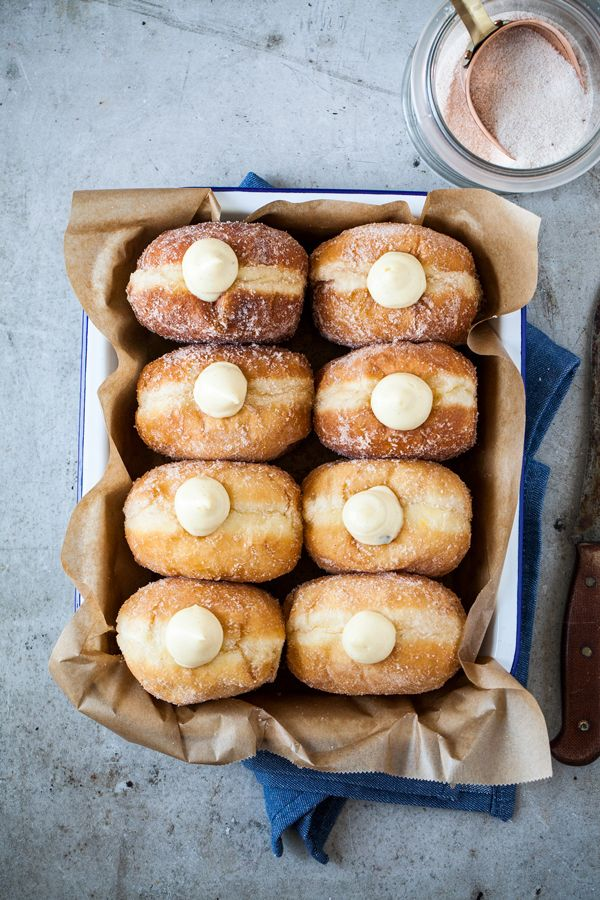 Homemade brioche doughnuts with rich vanilla cream. Not too big, not too oily. Soft, airy inside and filled with the most delicious vanilla cream.