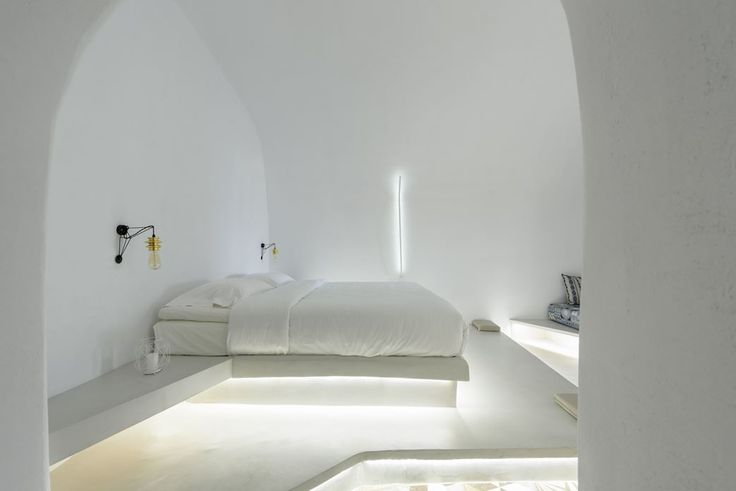 Solstice Luxury Suites is located in Oia village on the island of Santorini. It consists of small cave like structures and one aboveground studio with courtyards that are designed to follow the natural slope of the landscape #bedroom