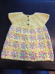Dress takes about 5 (6, 7) ounces white, 1 (1, 2) ounces avocado and 2 (2, 3) ounces yellow 3-plv sport weight yam. Use aluminum crochet hooks sizes E, F and G; three ½-inch buttons; and a large eye needle.