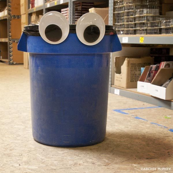 Giant Googly Eyes added to a trashcan to make a monster for a kids room