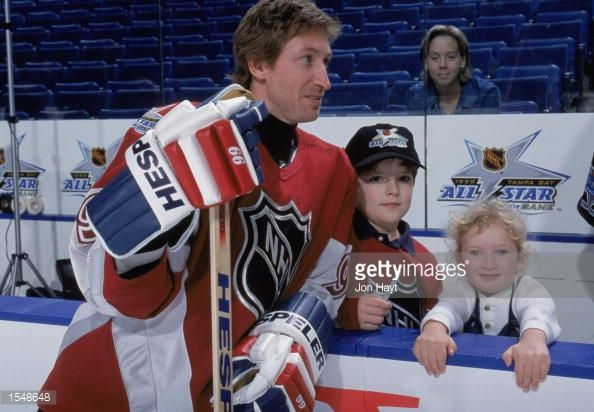 Wayne Gretzky of the North America Team poses for pictures with fans during practice skate on game day of the NHL All-Star game against the World team on January 2, 1999 at St. Pete Times Forum in...