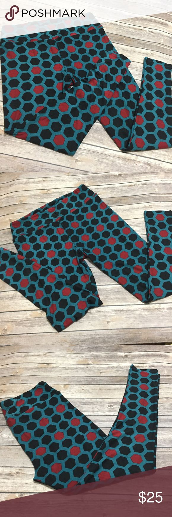 LuLaRoe TC Leggings LuLaRoe Tall & Curvy (TC) black, blue & red honeycomb-like design Leggings. Never worn, never tried on, NWT (if you know LLR leggings you know that although they're NEW, leggings DO NOT come with an actual tag since the tag since would ruin the fabric). There are cards, however you will only get a card if you buy TWO leggings. *I'm not a LuLaRoe Consultant! LuLaRoe Pants Leggings