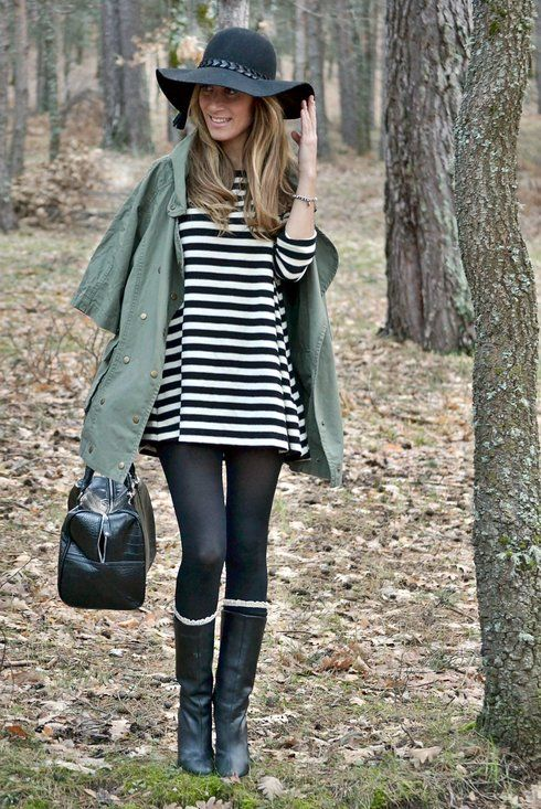 Black & White Striped Shirt, Black Leggings, Black Boots, & a Green Jacket