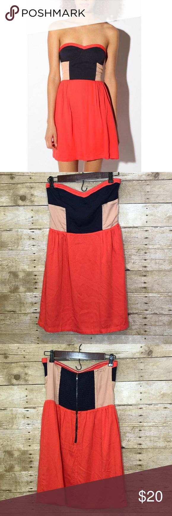 """UO Sparkle & Fade Strapless Dress Color Block Red Really cute Urban Outfitters dress. Has a nice color blocking with a bright coral red, navy blue and nude. Zips up the back. Good condition. One of the inside hanging straps has been cut off.   Measurements: Armpit-Armpit: 14.5"""" Waist (flat across): 13.5"""" Length (Shoulder-Bottom Hem): 27""""   Please ask if you have any questions and see other listings! Urban Outfitters Dresses Mini"""
