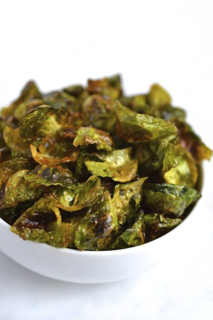 Brussel sprout leaves turn into crispy chips when baked in the oven. A delicious and healthy snack! (Paleo, Vegan, Whole30, Grain/Gluten Free, SCD)