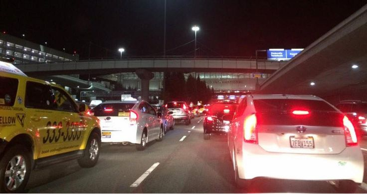 Taxi drivers at San Francisco International Airport caused massive traffic issues Monday night when they began circling the lower domestic loop of the airport protesting the rideshare services, Uber and...