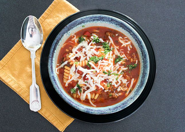 Another Lasagna Soup. Hot tomato and sausage soup is ladled over a surprise: a cheesy scoop of fresh ricotta and Parmesan.