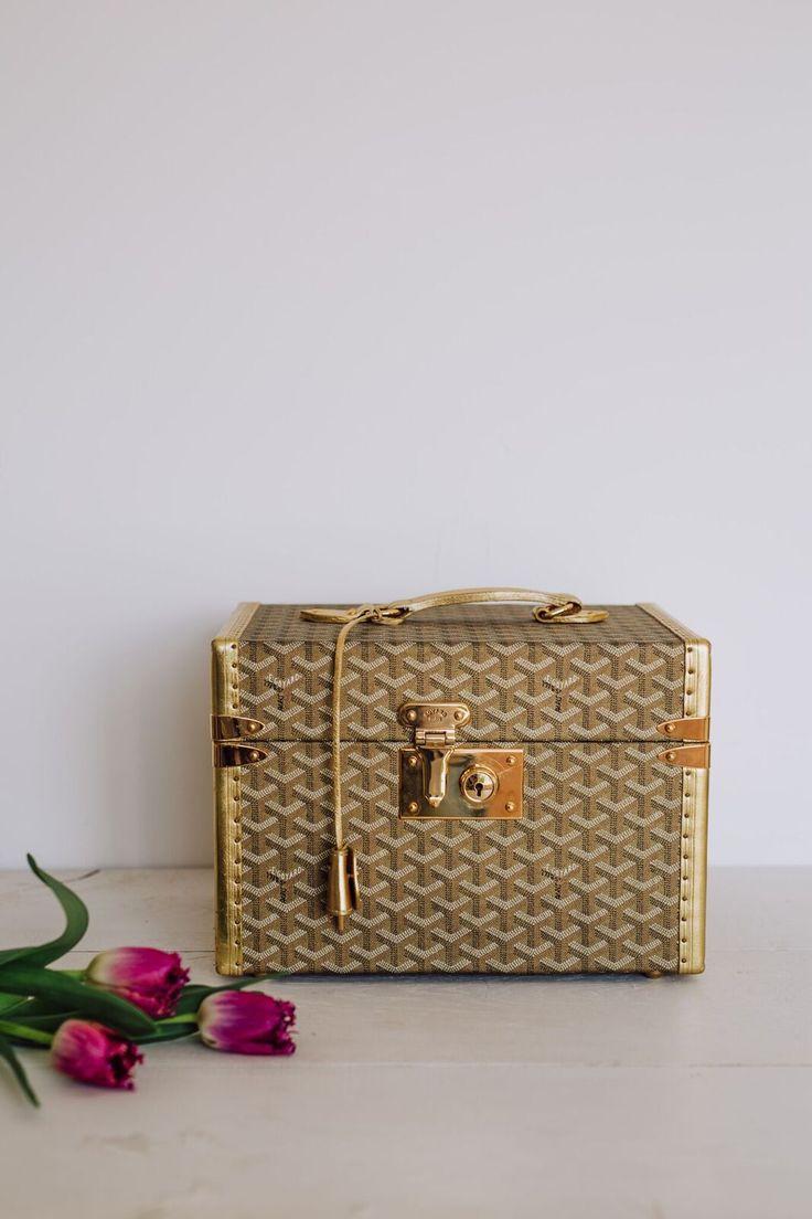 Goyard gold vanity case.