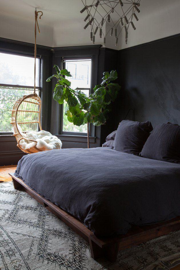 Bedroom With Matte Black Walls And Black Bedding With Hanging Chair In The Window Black Walls Bedroom Dark Home Decor Bedroom Interior