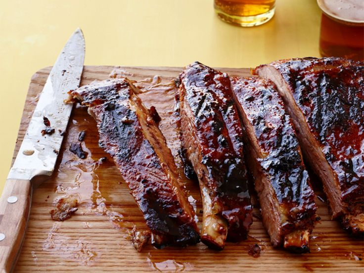 Chili-Glazed Pork Ribs : Basting these ribs with homemade chili-spiked sauce every 10 minutes for the last 40 minutes of cooking creates a spicy glaze.