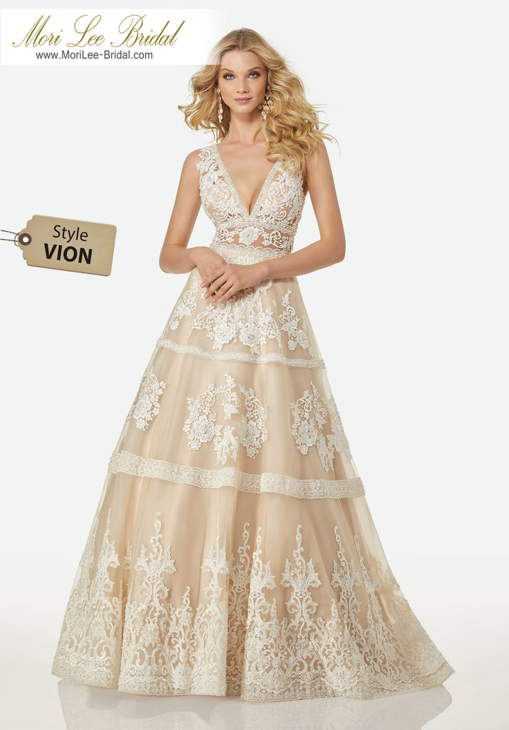 Style VION MICHELLE WEDDING DRESSDeep V-Neckline, Full A-Line Gown with Tonal Beaded Venice Lace Appliqués on Tulle.Colors available: Ivory, Ivory/Almond.