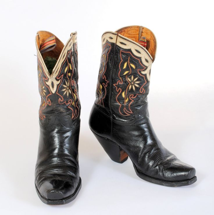 Vintage fancy cowboy boots with stitched and inlaid uppers and a buckaroo  style heel. With firm buckaroo style, they look ready to boot-scoot-boogie!