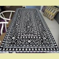 Love the idea of making a stenciled rug with this pattern. Could be a fun idea for the garage or deck.
