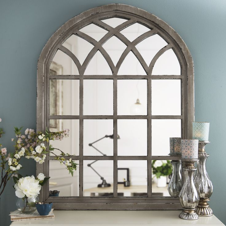 Our Distressed Cream Sadie Arch Mirror has a striking design that will fit any decor and add rustic flair.