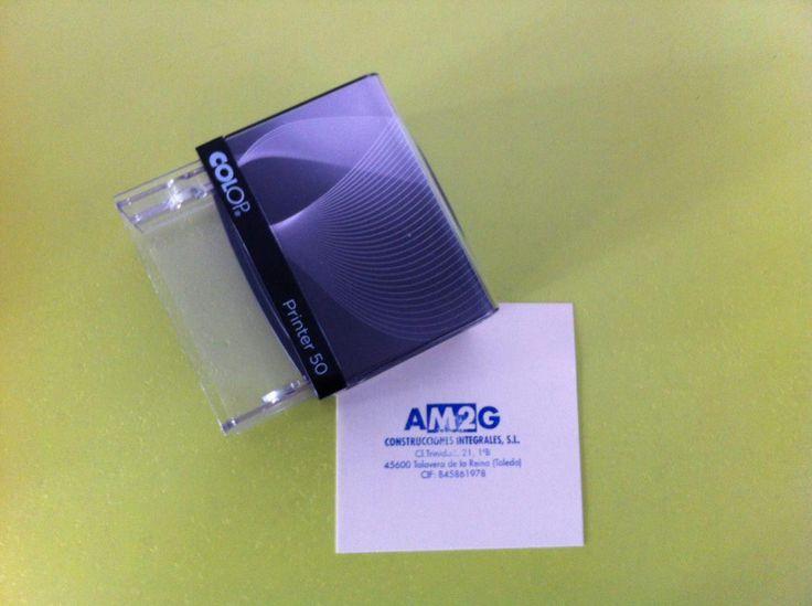 "Sello rectangular autoentintable ""AM2G Construcciones Integrales"""