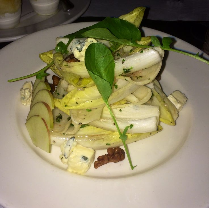 Endive salad with Brie cheese, walnuts, and thinly sliced apples.