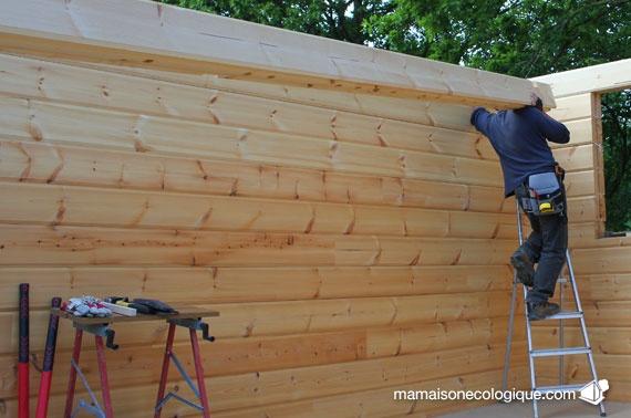 Maison bois : pose d'un madrier 135x200x9000