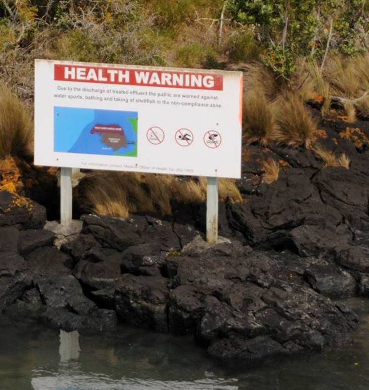 Health warning at Puketutu Island, by the Watercare wastewater treatment plant, Manukau Harbour, Auckland, New Zealand