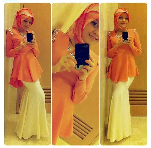 Hijabi. Pwplum over a fishtail skirt.