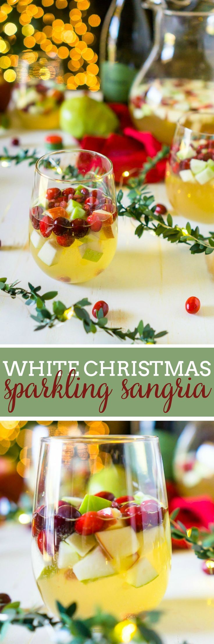 I'm dreaming of a White Christmas Sangria, filled with tasty red and green fruit for a festive holiday cocktail! Fill up the sangria pitcher with red and green apples, pears, cranberries and pomegranates, and some white wine and Prosecco, too, of course, for a sparkling sangria! Lightly sweet with tangy fruit makes a Christmas Sangria Recipe your guests will love! | The Love Nerds #Sponsored #christmascocktail #holidaycocktail #whitesangriarecipe