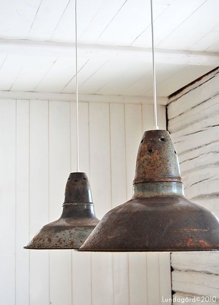 Vintage industrial pendant lights - love this shabby effect against rustic white walls.