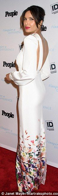 Elegant: The New Dehli-born presenter easily defied her 47 years in the backless cut-out c...