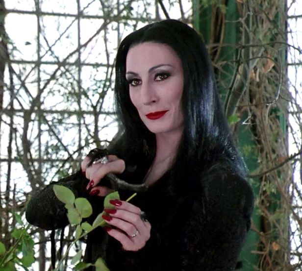 July 8: Anjelica Huston! Pictured here as Morticia Addams, the role she played in the movies 'The Addams Family' (1991) and 'Addams Family Values' (1993).