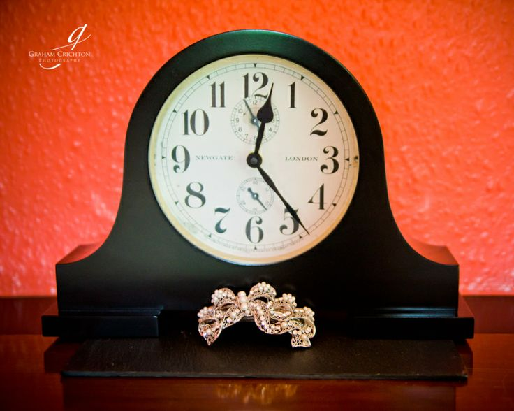 Filigree and pearl bow bridal hair accessory on mantel piece clock. www.grahamcrichton.com