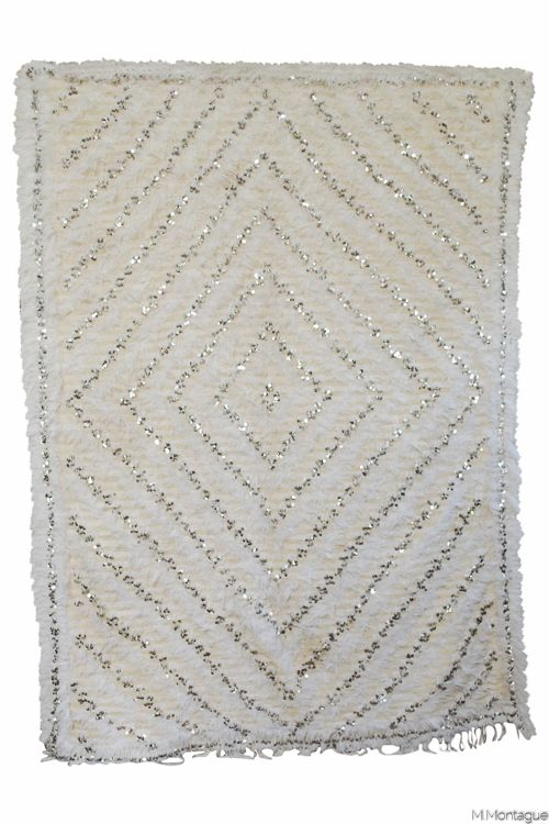 Holy moly! The most most beautiful vintage Moroccan wedding blanket. Absolutely incredible nested diamond pattern with shiny sequinning. Available on M.Montague Online Souk! http://www.mmontague.com/textiles-inventory/vintage-moroccan-wedding-blanket-3131